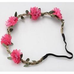 Trendy bohemian gevlochten haarbandje met blaadjes en roze bloemetjes