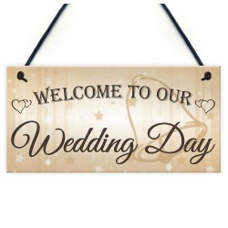 Houten bord aan touw met de tekst Welcome to our Wedding