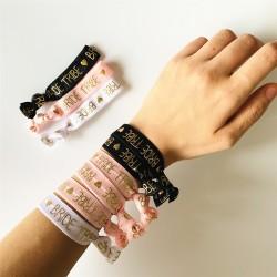 Elastische armband wit, roze of zwart met gouden opdruk Bride of Bride Tribe met hartje
