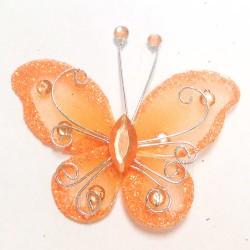 Letterlijk en figuurlijk schitterende organza vlinder met metaaldraad langs de randen oranje