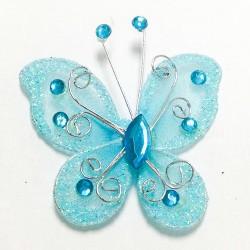Letterlijk en figuurlijk schitterende organza vlinder met metaaldraad langs de randen turquoise